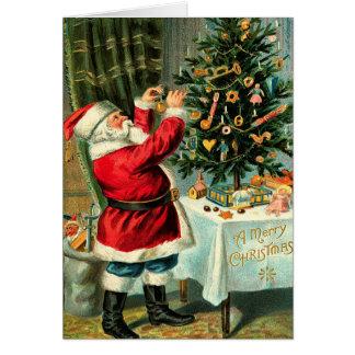 Vintage Papá Noel que adorna el árbol Tarjeton