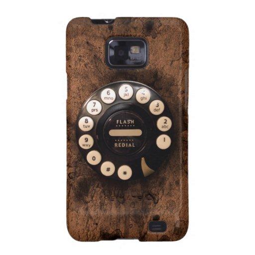 Vintage Rotary phone dial on brown grunge wall Samsung Galaxy SII Fundas