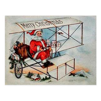 Vintage Santa del navidad en el aeroplano Postal