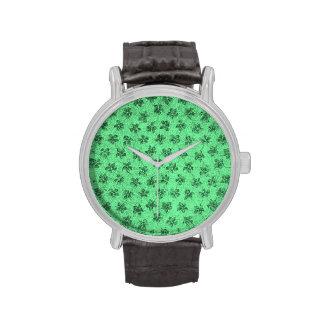 Violetas verdes florales del vintage reloj