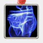 Vista luminescente del corazón humano adorno navideño cuadrado de metal