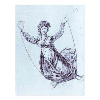 Vuelo joven de la bruja con una cuerda de postal