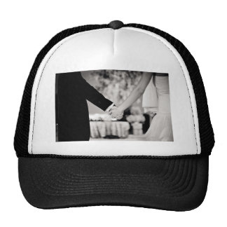 Wedding couple bride groom holding hands back and gorras
