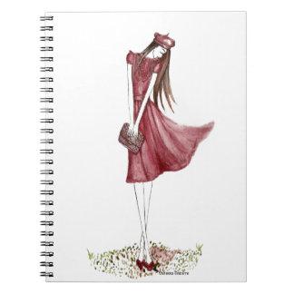 Woman in burgundy libros de apuntes con espiral