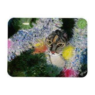Y un gato en un imán del árbol de navidad