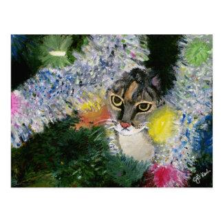 Y un gato en una postal del árbol de navidad