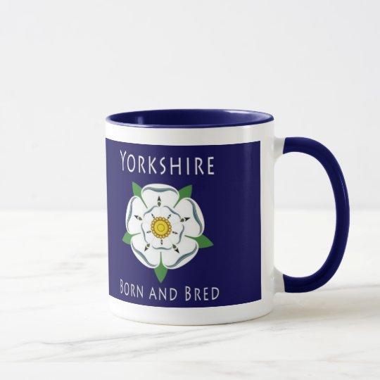Yorkshire llevado y crió la taza