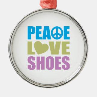 Zapatos del amor de la paz adorno redondo plateado
