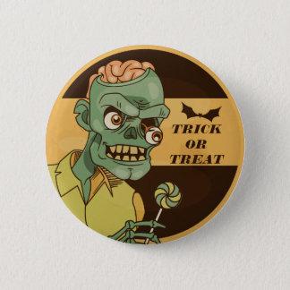 Zombi espeluznante con el botón del Pin del