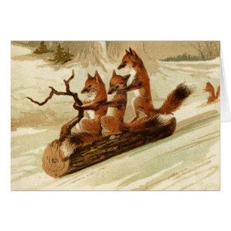 Zorros del vintage Sledding la tarjeta de Navidad